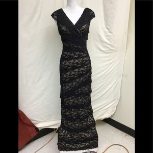 Marina black tiered lace and sequin gown w/lining.